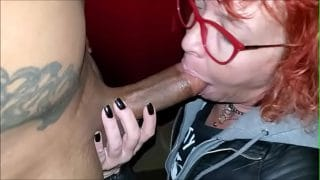 Redhead granny with glasses sucking a young bbc